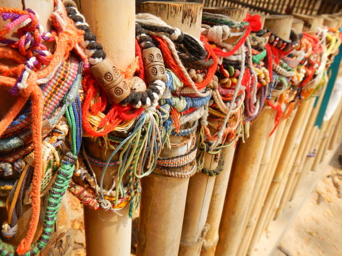 High angle view of bracelets on bamboos for sale at market stall