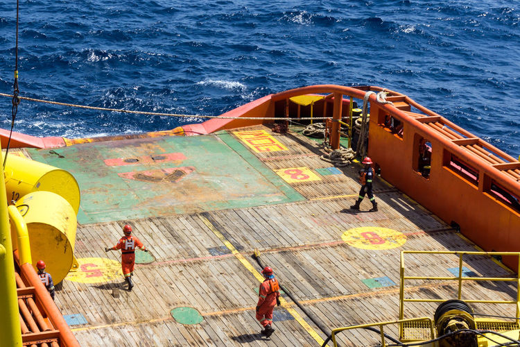 anchor handling job Construction Barge Ship Ocean Sea Maritime Able Bodied Seamen Installation Offshore Offshore Life Oil Gas Oil And Gas Industry Oil Field Anchor Handling Tug Vessel Safety Buoy Deck Work Worker Job Water Nautical Vessel Sea Boat Deck High Angle View Boat