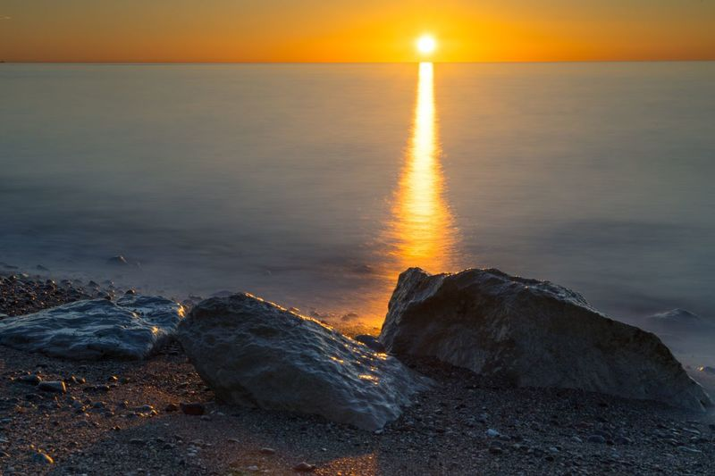 Sea Sunrise Long Exposure Beauty In Nature Sun Horizon Over Water Nature Tranquility Scenics Tranquil Scene Beach Water Rock - Object No People Idyllic Outdoors Sky Sunlight Sand Wave Day Guadalmina Andalucía SPAIN