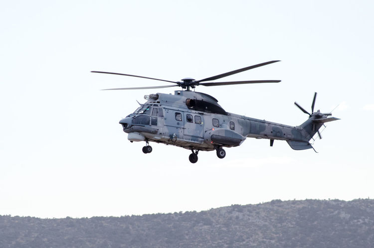 Super puma helicopter Eurocopter Aggression  Air Vehicle Clear Sky Copy Space Day Flying Government Helicopter Mid-air Military Mode Of Transportation Motion Nature No People on the move Outdoors Rescue Rescue Helicopter Sky Transportation