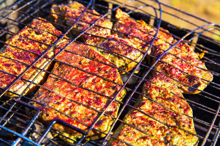 Barbecue Food Meat Grilled Barbecue Grill Food And Drink Freshness Preparation  Heat - Temperature Close-up No People Wellbeing Healthy Eating Day Outdoors Focus On Foreground Nature High Angle View Burning Metal Preparing Food Char-grilled Dinner Temptation