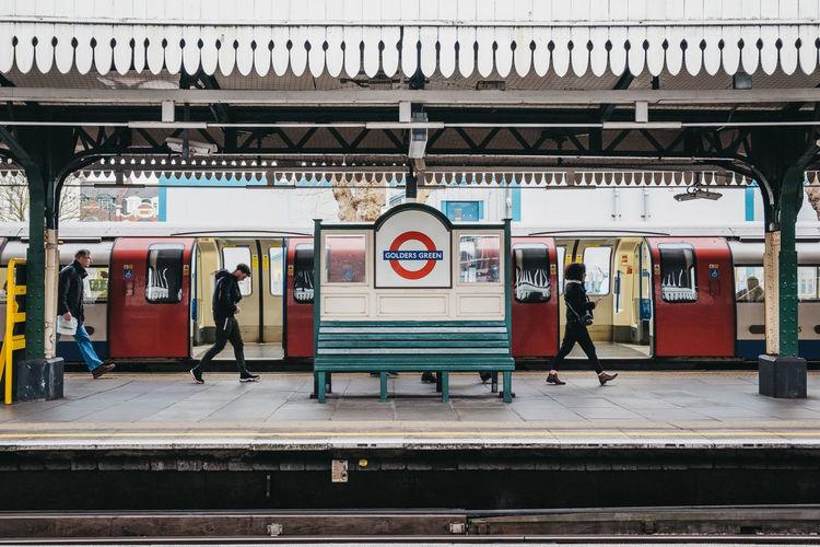 Station name sign on the outdoor platform of golders green tube station, london, uk