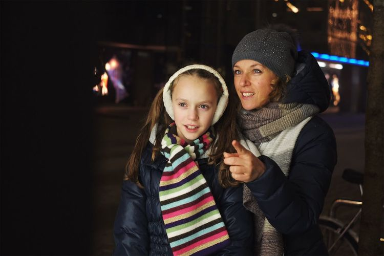 Mother and daughter window shopping. Child Girls Togetherness Daughter Family With One Child Mother Childhood Looking At Camera Portrait Warm Clothing Happiness Family Bonding Smiling Christmas Winter Night Real People People Close-up Authentic Moments Shopping ♡