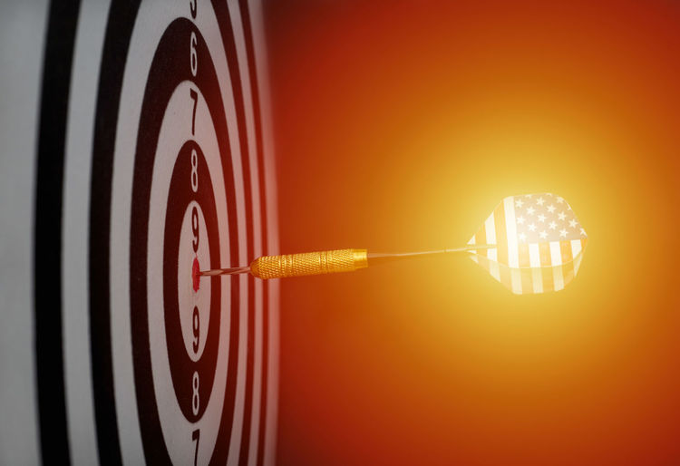 Center target of darts isolated on a black background Dartboard Bulls-eye Win Successful Center Public Metaphor Point Result Dart Targeting Victory Black Sport Board Mark Perfection Strategy Relations Conceptual Target Marketing Challenge Media Isolated American Circles Red Hit White Accuracy Objects Luck Accurate Perfect Arrow Patterns Ideas Game Flag Concept Direct Bull Success Eye Market Winner Background Play Sports Target No People Studio Shot Light Bulb Number Indoors  Orange Color Lighting Equipment Close-up Illuminated Single Object Achievement Glowing Wall - Building Feature Clock Time Circle Clock Face