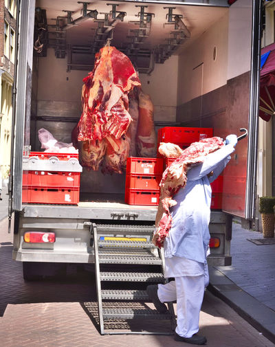 Cooling truck with fresh transport with beef meat or red meat in a scene. Beef Butcher Shop Cooling  Freshness Meat! Meat! Meat! Transport Transportation Beef Meat Business Butcher's Trade Butchered Butchers Butchershop Butchery Food Food And Drink Fresh Fresh Meat Freshness Meat Pork Meat Red Meat Retail  Selling Food Truck