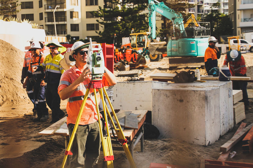 Adult Adults Only Camera - Photographic Equipment Construction Construction Site Day Heavy Machinery Labour Manual Worker Occupation Occupational Safety And Health Only Men Outdoors People Real People Surveyor Teamwork Work Working Workmen
