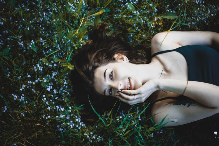 Portrait of woman lying down on plant