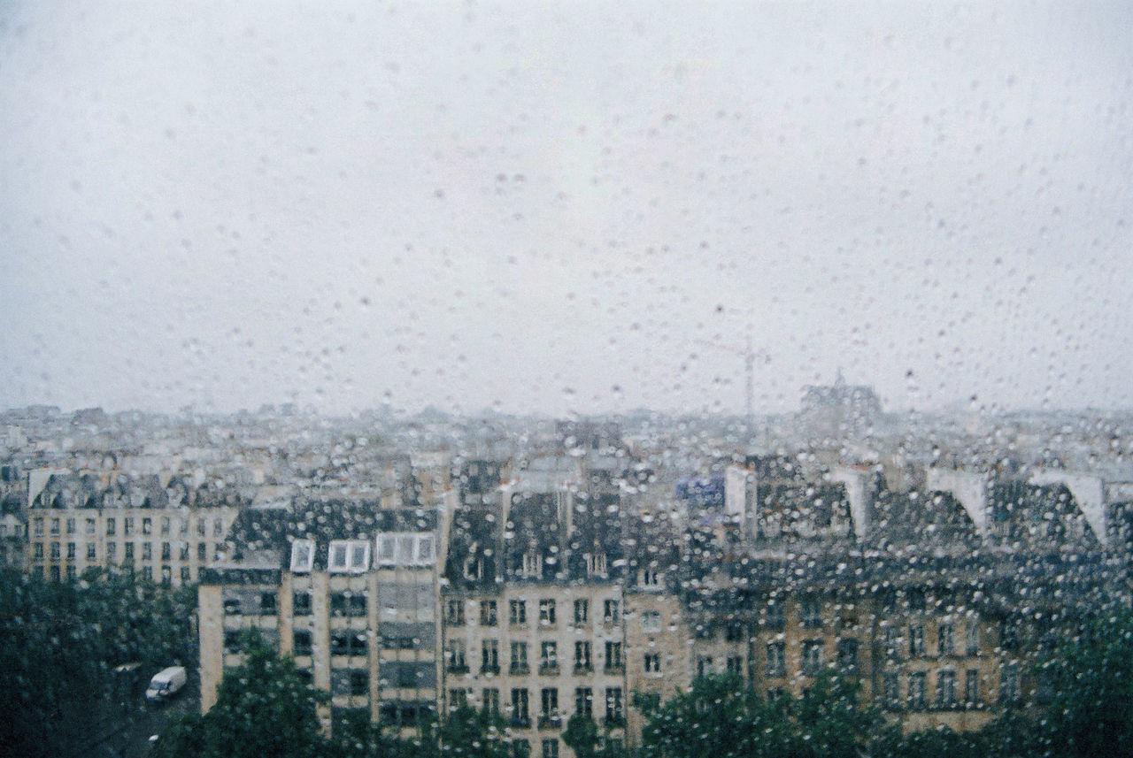 window, weather, rain, architecture, wet, building exterior, drop, city, cityscape, raindrop, no people, sky, built structure, day, water, outdoors, bleak, nature