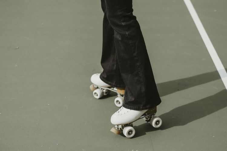 Low section of woman skating on rollelskate