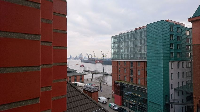 Harbor in the distance. Hamburg Germany Hh Elbe Elbe River Port Harbor Hanseatic Hansestadt Bricks Red Cranes Work Distance Window View View From The Window Gray Clouds And Sky Clouds Cloudy Architecture Urban Landscape Cityscape