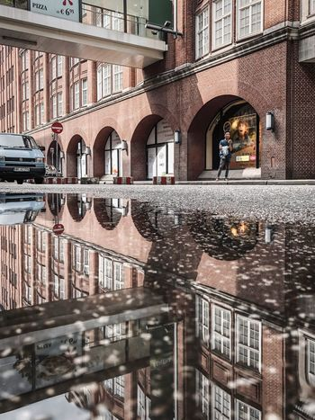Built Structure Building Exterior Architecture Water Building Reflection City Puddle No People Transportation Wet Residential District Mode Of Transportation Day Waterfront Connection Window Canal Rain Arch