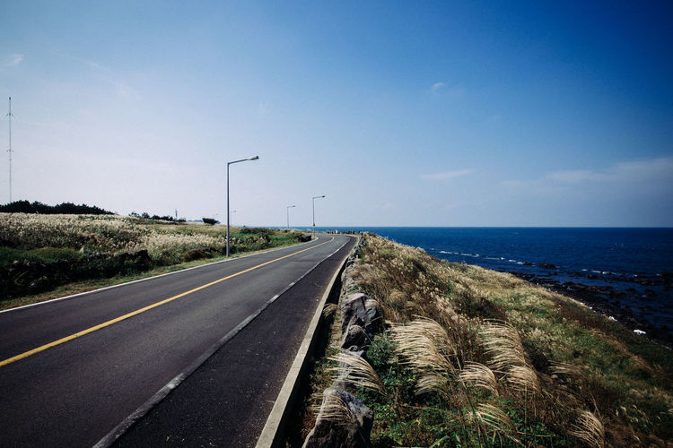 Road By Sea Against Sky