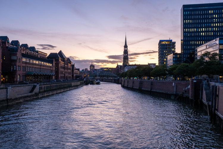 River passing through city at dusk