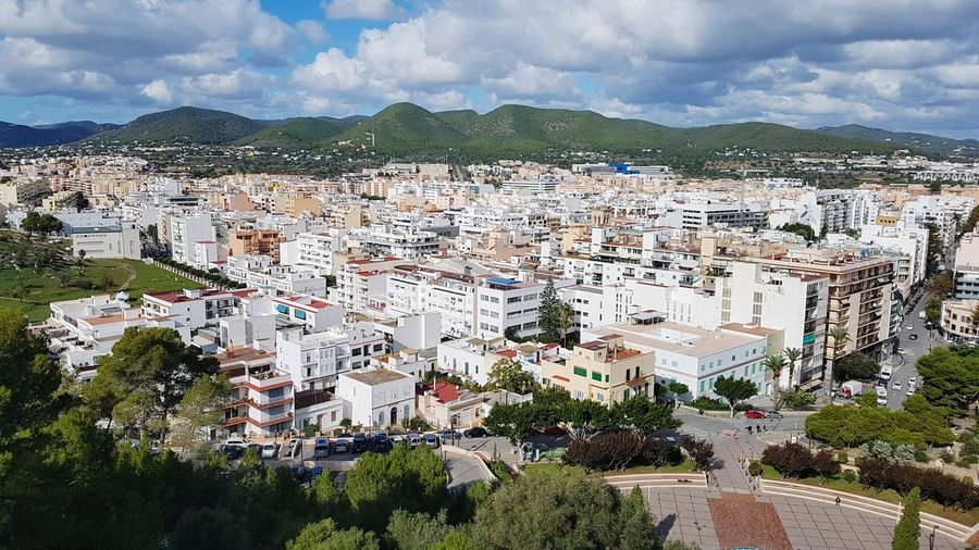 Beautiful view Beautiful View Upstairsview Sky Heavy Clouds White White Color White Houses Travel Travel Destinations Center Oldtown Citycenter Eivissa Ibiza Ibiza, Spain Ibiza2018 Island Laisla Balearic Islands Baleares Mountain Tree Cityscape Sky Cloud - Sky Building Exterior Postcard Urban Scene