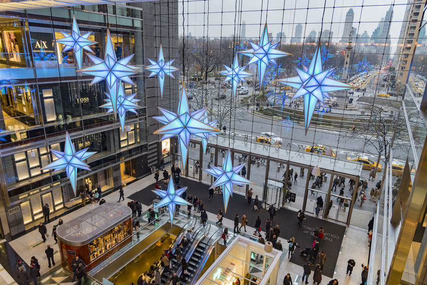 Time Warner Center Holidays Architecture Business Business Finance And Industry City Day Hanging Holiday Illuminated Indoors  Large Group Of People New York City People Shopping Stars Time Warner Center Winter
