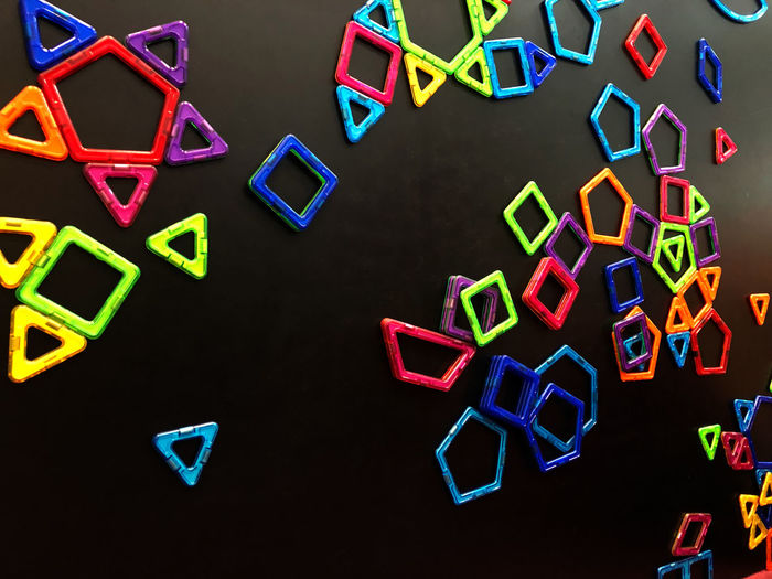Many magnets are stuck on the blackboard. Toy Magnet Magnetic Play Background Colorful Education Child Plastic Game Object Triangle Geometry Concept Cute Figure Children Creativity Preschool Designer  Kid Happy Color Geometric Construction Home Childhood Learn Symbol Connect School Set Closeup Bright Little Wall Shape Green Abstract Baby