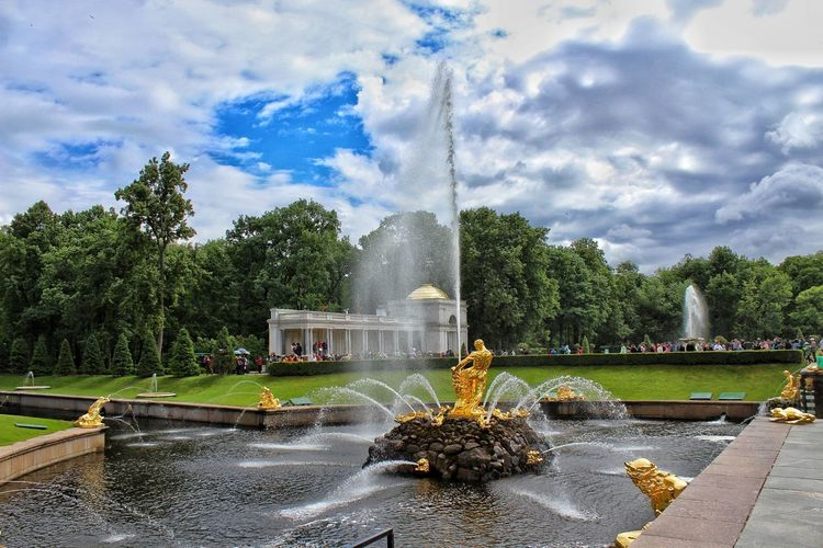Peterhof- summer palace of Peter the Great. Palace Tree Water Spraying Irrigation Equipment Motion City Statue Long Exposure Splashing Fountain