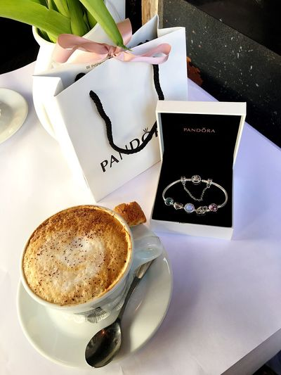 Coffee Cup Coffee - Drink Drink Refreshment Food And Drink Text Table Freshness Cappuccino Saucer High Angle View Indoors  Latte Flower Frothy Drink No People Froth Art Communication Cafe Close-up Pandora Pandora Bracelet  Copenhagen Coffee Morning