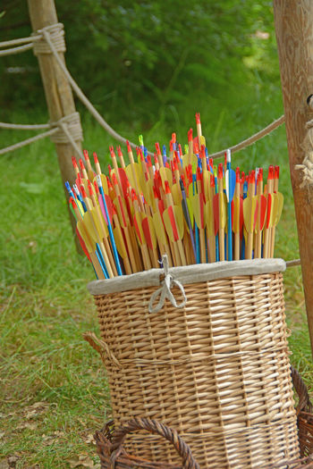 Archery Range Arrows Bamboo - Material Basket Basket Of Arrows Close-up Day Grass Large Group Of Objects No People Outdoors Picnic Basket EyeEmNewHere Breathing Space Quivers Large Group Basket Use