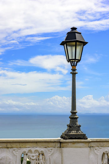 Urban Lampposts on ancient wall with the sea in the background in the city of Salvador, Bahia Lantern Street Light Wall Architecture Baia De Todos Os Santos Beauty In Nature Blue Close-up Cloud - Sky Decorative Eletric Energy Horizon Over Water Lampost Lighting Equipment Nature No People Old Outdoors Scenics Sea Sky Street Light Urban Water