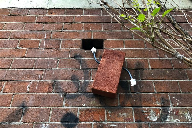 Streetart Urban Art Mickey Mouse Day High Angle View No People Brick Pattern Architecture Built Structure