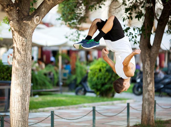 Acrobatic Active Adrenaline Athlete Caucasian Exercise Extreme Free Horizontal Man Motion Outdoor People Somersault  Street Teenager Traceur Urban