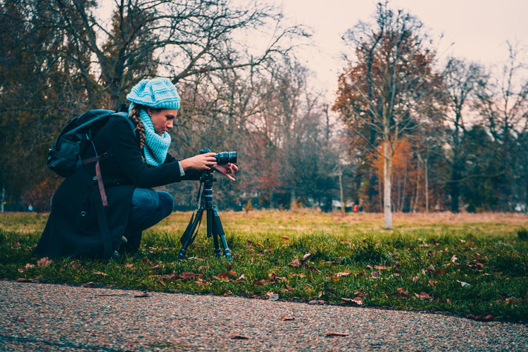 Woman Photographing In Park