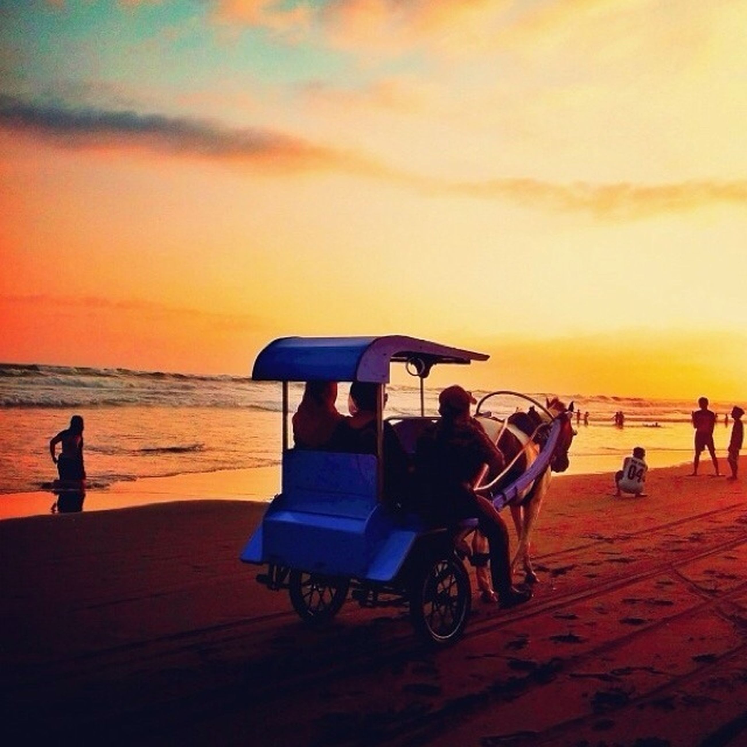 sunset, sea, beach, sky, horizon over water, water, lifestyles, leisure activity, orange color, men, silhouette, person, shore, scenics, sand, cloud - sky, beauty in nature, vacations, sitting