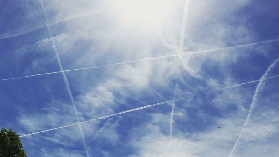 Sky game.. Vapor Trail Contrail Blue Sky Clouds Lines Geometric Shape Patterns Sun Backgrounds Copy Space Low Angle View No People Beauty In Nature Nature Outdoors Eyecatcher Summer Patternseverywhere Patterns Stripes Patterns And Designs In Nature Patterns I See Day