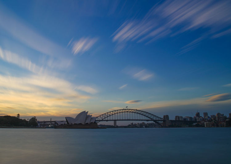 Sydney Harbour Bridge and Opera House at Sunset Clouds And Sky Cloudscape Landscape Long Exposure Mrs Macquarie Point Ocean Sunset Sydney Harbour Bridge Sydney Opera House Sydney, Australia Capturing Movement