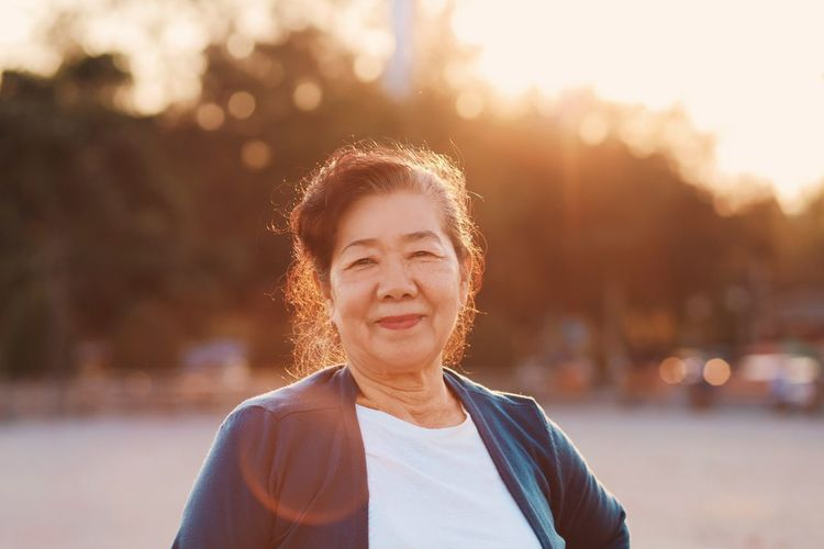 Portrait of senior woman standing outdoors