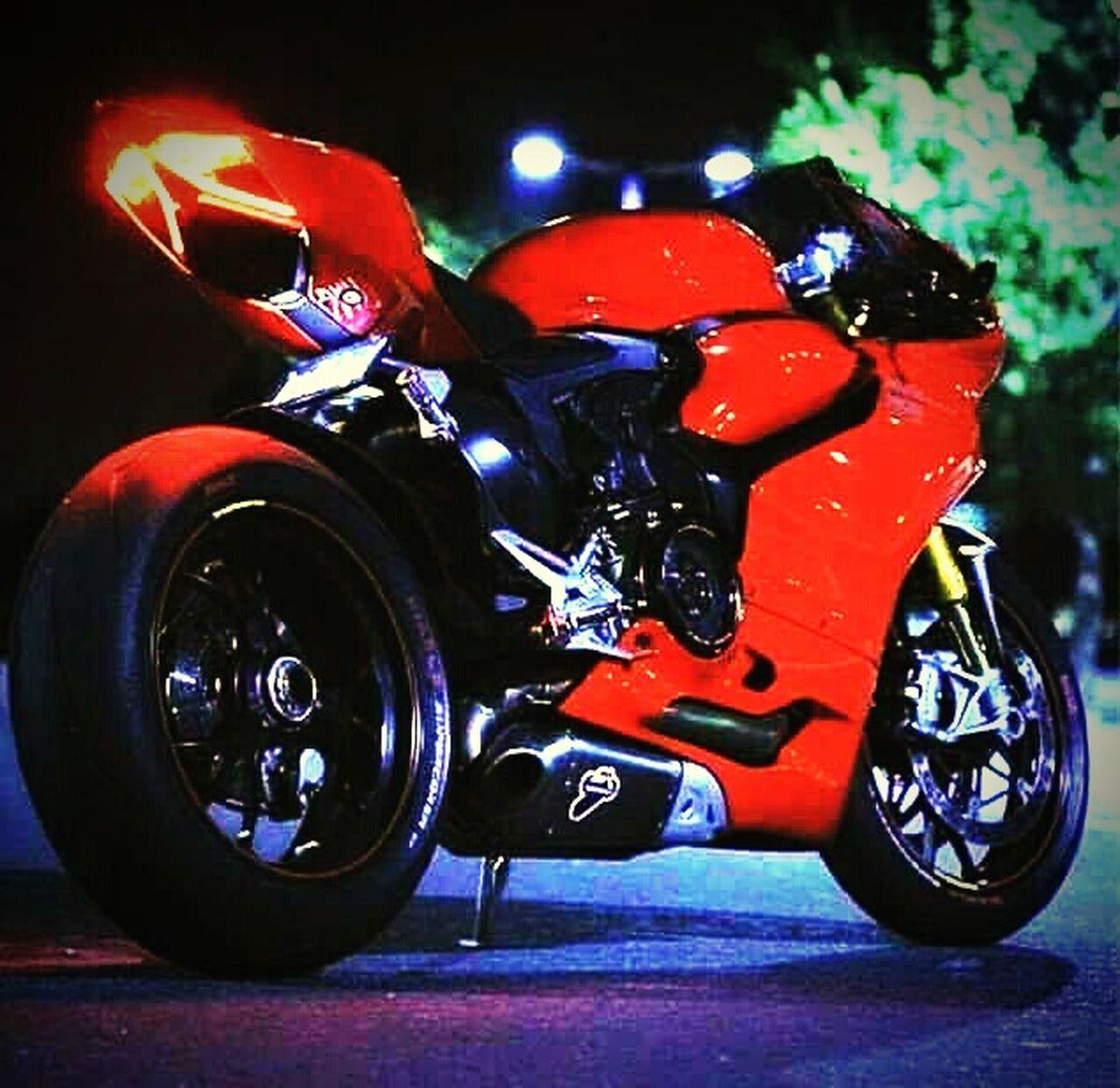 motorcycle, red, motorsport, crash helmet, motorcycle racing, speed, land vehicle, sports race, helmet, headwear, outdoors, close-up, night, auto racing, no people