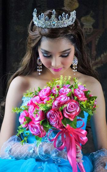Beautiful woman holding flower bouquet