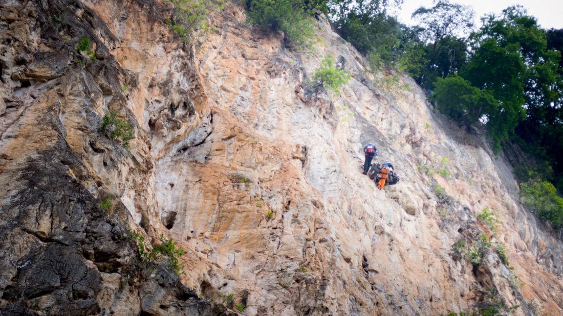 Rock climbing at Batu Caves, Selangor, Malaysia Climber Nature RISK Adventure Belayer Big Wall Cliff Climbing Danger Hand Height High Angle View Men Multipitch Outdoor Photography Outdoors Photography Portrait Rock Climber Rock Climbing