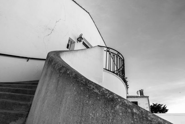 Stairway in Ars en re. Minimal picture. Monochrome photography. Black & White Stairs Architecture Building Building Exterior Built Structure Cloud - Sky Day Direction Directly Below Ladder Low Angle View Metal Monochrome Nature No People Outdoors Railing Sky Spiral Staircase Staircase stairways Steps And Staircases Wall Wall - Building Feature
