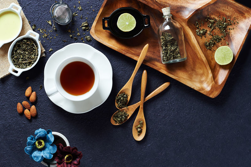 Tea cup and ingredients on table