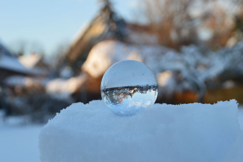 Close-up of crystal ball in snow