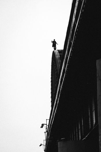 Suicidal man standing on the top of the bridge Architecture Bridge Built Structure Clear Sky Day Full Length Low Angle View Men One Person Outdoors People Real People Silhouette Suicidal The Photojournalist - 2017 EyeEm Awards Walking The Street Photographer - 2017 EyeEm Awards Lost In The Landscape Adventures In The City Focus On The Story #FREIHEITBERLIN The Traveler - 2018 EyeEm Awards The Photojournalist - 2018 EyeEm Awards The Troublemakers