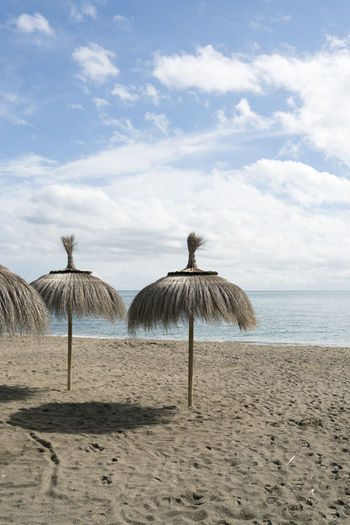 Beach Parasol Empty Beach Deserted Beach Deserted Straw Parasol Straw SPAIN Sky Cloud - Sky Land Beauty In Nature Scenics - Nature Sand Sea Water Tranquility Tranquil Scene Nature Day Non-urban Scene No People Horizon Over Water Outdoors Horizon