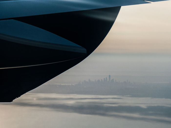 arriving at nyc Landing Misty New York City Skyline Airplane Airplane Wing Approaching New York City Architecture Building Exterior City Engine Exhaust Flying Fumes Landing In New York City Sea Sky Transportation Travel Travel Destinations Water