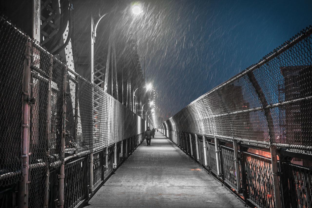Illuminated Railing Against Sky At Night