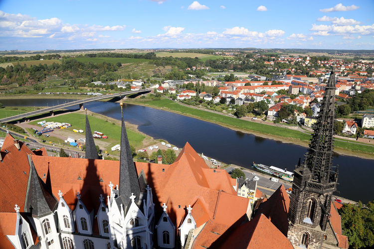 High angle view of meissen cathedral and elbe river against sky in town