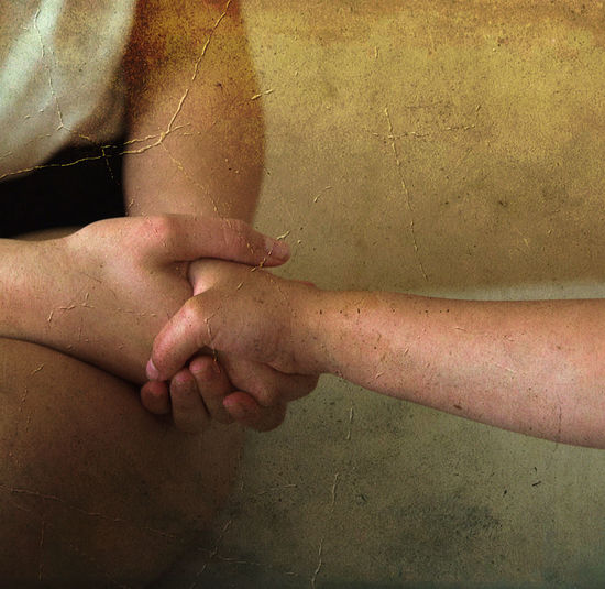 Midsection of woman touching hands