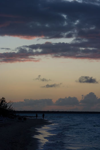 Sunset in the Caribbeans with a cloudy sky Sky Cloud - Sky Sunset Water Beauty In Nature Sea Scenics - Nature Silhouette Beach Land Nature Tranquility Tranquil Scene Horizon Horizon Over Water Orange Color Non-urban Scene Outdoors People Caribbean Sunset