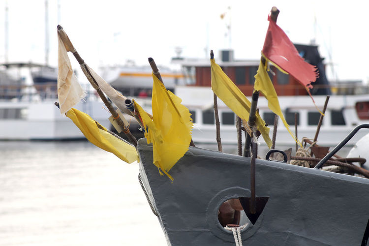 Close-up of yellow flags hanging on boat