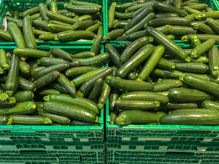 Full Frame Shot Of Zucchini For Sale At Market Stall