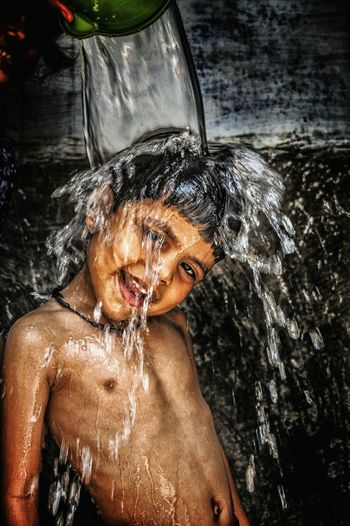 Water pouring over boy