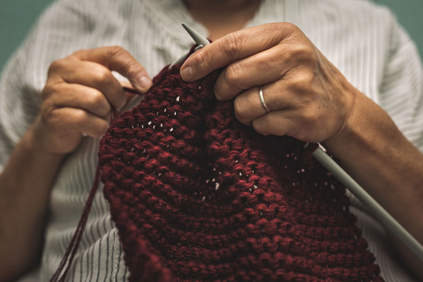 close up of old woman's hands knitting Wool Knitting Hand One Person Human Hand Textile Holding Knitting Needle Art And Craft Midsection Close-up Indoors  Craft Creativity Human Body Part Skill  Adult Real People Senior Adult Finger Old Woman Cosy