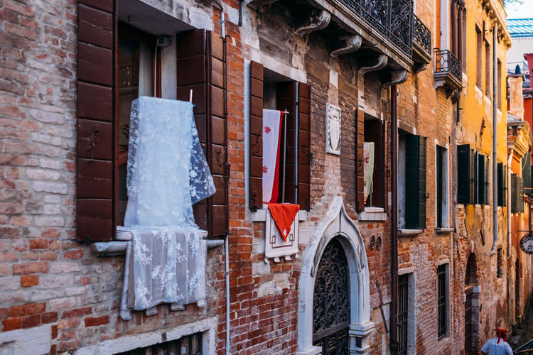 Venice Architecture Building Exterior Built Structure Building Window Brick Day No People Wall Brick Wall Wood - Material Outdoors Hanging Residential District Low Angle View Red City Old Construction Site Wall - Building Feature