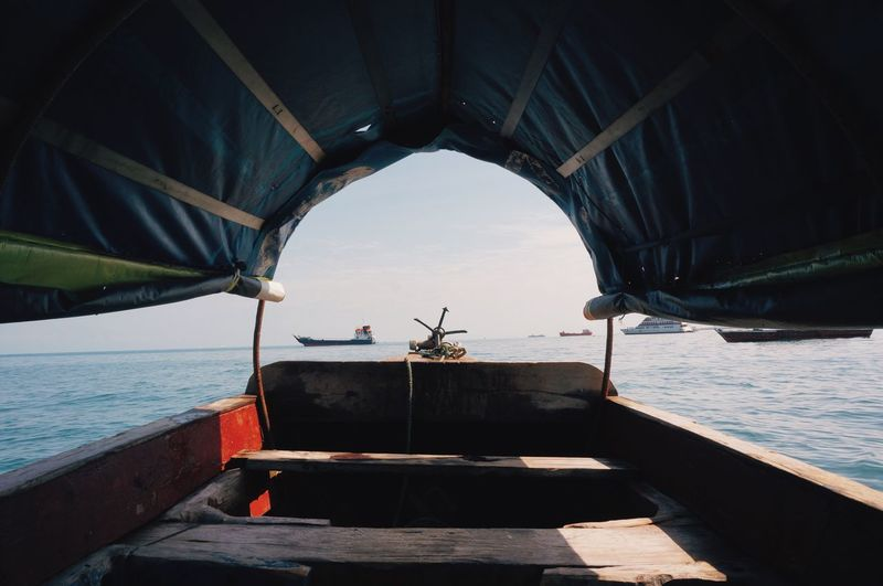 Wooden Boat Sailing In Sea Against Sky